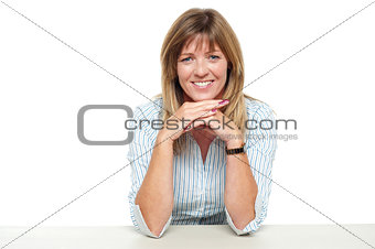 Smiling business lady sitting idle in office