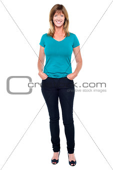Casual trendy woman with hands in jeans pocket
