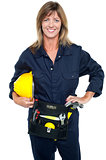 Self assured female architect holding hard hat