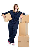 Charming woman in uniform posing with cartons