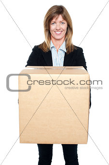 Business lady holding packed carton
