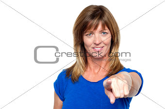 Casual woman pointing towards you