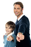 Charming father and son pointing at you