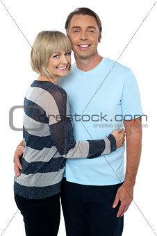 Charming middle aged lady embracing her husband