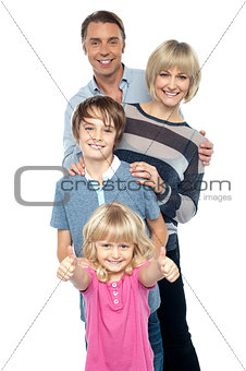 Group portrait of a playful family of four