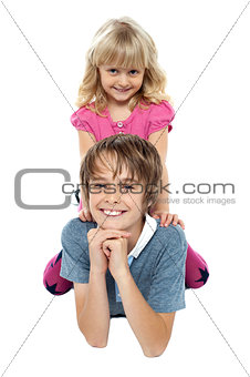 Adorable sister sitting on her brothers back