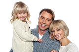 Cheerful family of three posing for camera