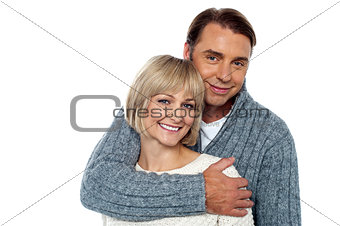 Stylish man embracing his wife from behind