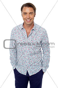 Casual shot of smiling handsome relaxed male model