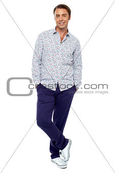 Calm and relaxed middle age man posing casually