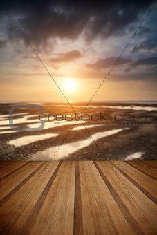 Beautiful vibrant Summer sunset over golden beach landscape