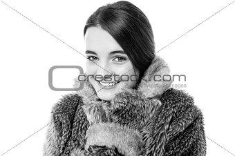 Cute young teen girl in fur jacket