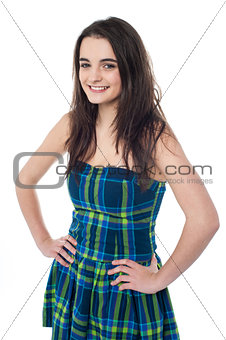 Attractive young girl with hands on waist