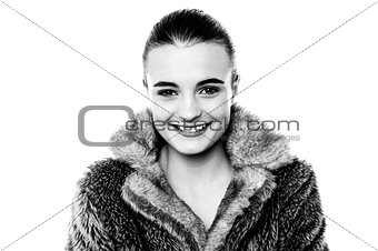 Smiling attractive girl in furry overcoat