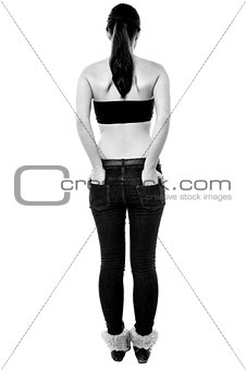 Back pose of a girl with hands in back pocket