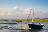 Summer evening landscape of leisure boats in harbor at low tide