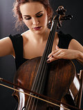 Closeup of a beautiful cellist