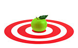 Green apple with leaf in center of red target