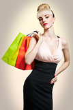 Woman holding shopping bags, Pin up hairstyle