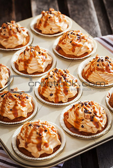 Caramel cupcakes on a baking tray