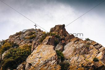 Cross on a stone mountain, Christian symbol