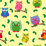 Seamless pattern with ornamental owls over yellow
