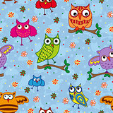 Seamless pattern with ornamental owls over light blue