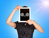 Young girl in dress covered her face with tablet. On screen code smiley