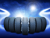 Wedge of car wheels. Abstract blue background
