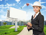 Businesswoman holding clipboard. Large billboard, road, grass hills and city as backdrop
