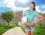 Girl builder holding paper scrolls, helmet. Green hills, road and buildings