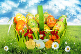 Basket With Easter Eggs On Green Grass
