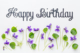 Happy birthday greetings with viola flowers