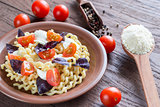 Fusilli lunghi with cheese and cherry tomatoes