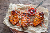 Grilled chicken breasts in hot mango sauce