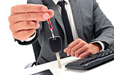 man in an office giving a car key