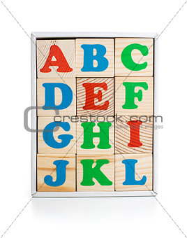 alphabet wood bricks in box isolated on white