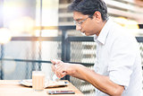 A man eating food at cafeteria.