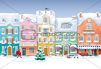 Old historical houses, shops and cafe at the snow-covered city s