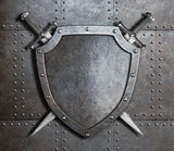 knight shield and two crossed swords over armor plates or gate