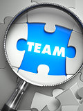 Team - Missing Puzzle Piece through Magnifier.