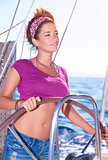 Beautiful woman driving a boat