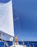 Happy woman on sailboat