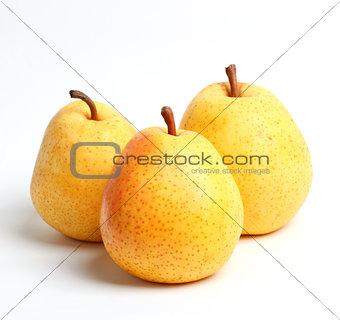 Three yellow juicy pears Closeup