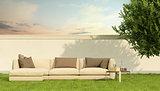 Elegant sofa in a garden