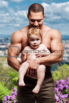 Athletic father with lovely little daughter