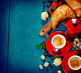 Breakfast with coffee, croissants and berries
