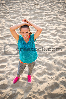 Portrait of fitness young woman on beach