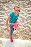 Portrait of healthy mother and baby girl on beach