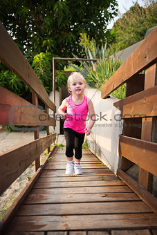 Portrait of fitness baby girl outdoors